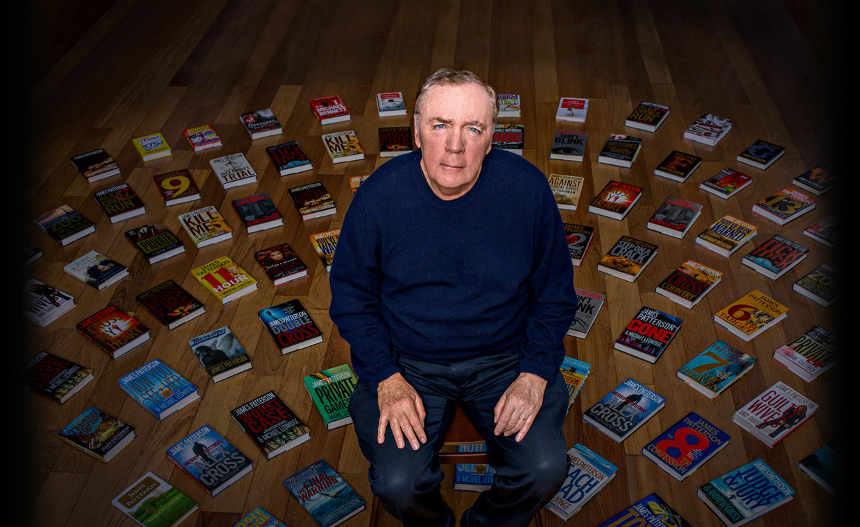 James Patterson surrounded by his books during his writing MasterClass
