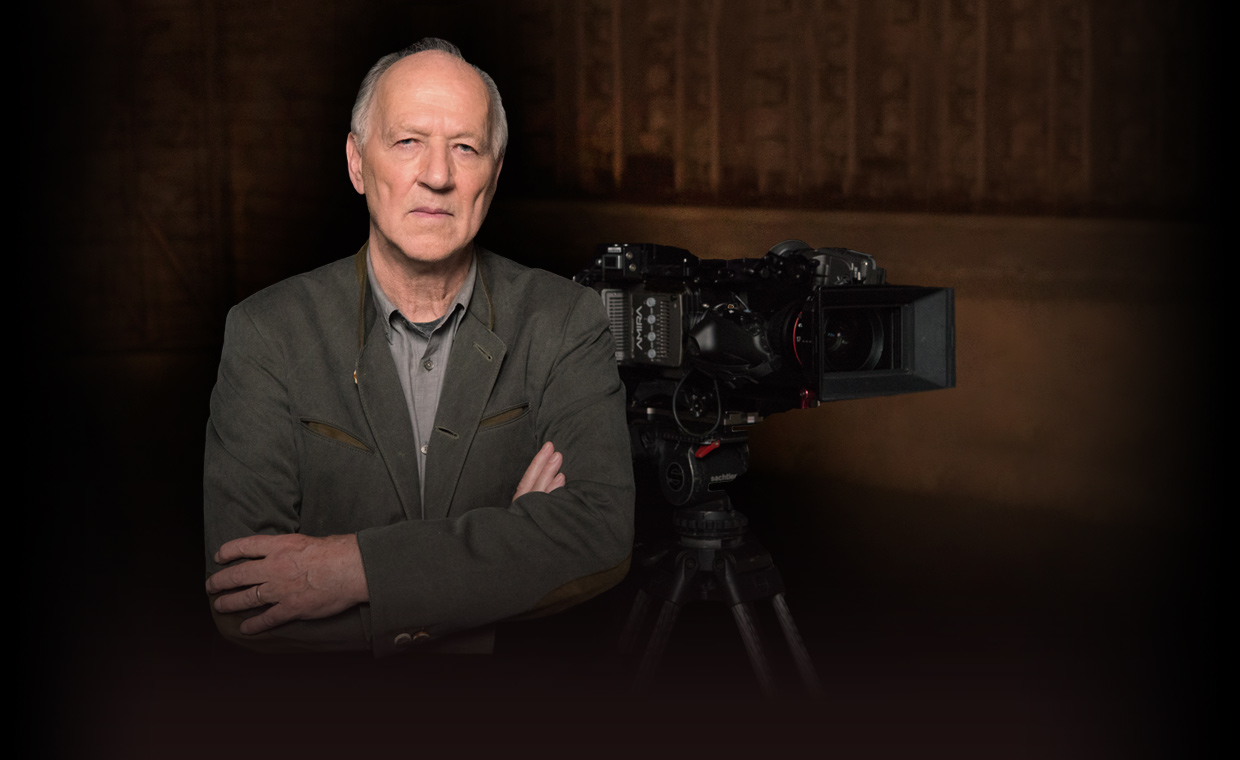 Director and filmmaker Werner Herzog stands with his camera for his online filmmaking MasterClass. Learn from Werner how to write scripts, choose locations, work with actors, and edit films